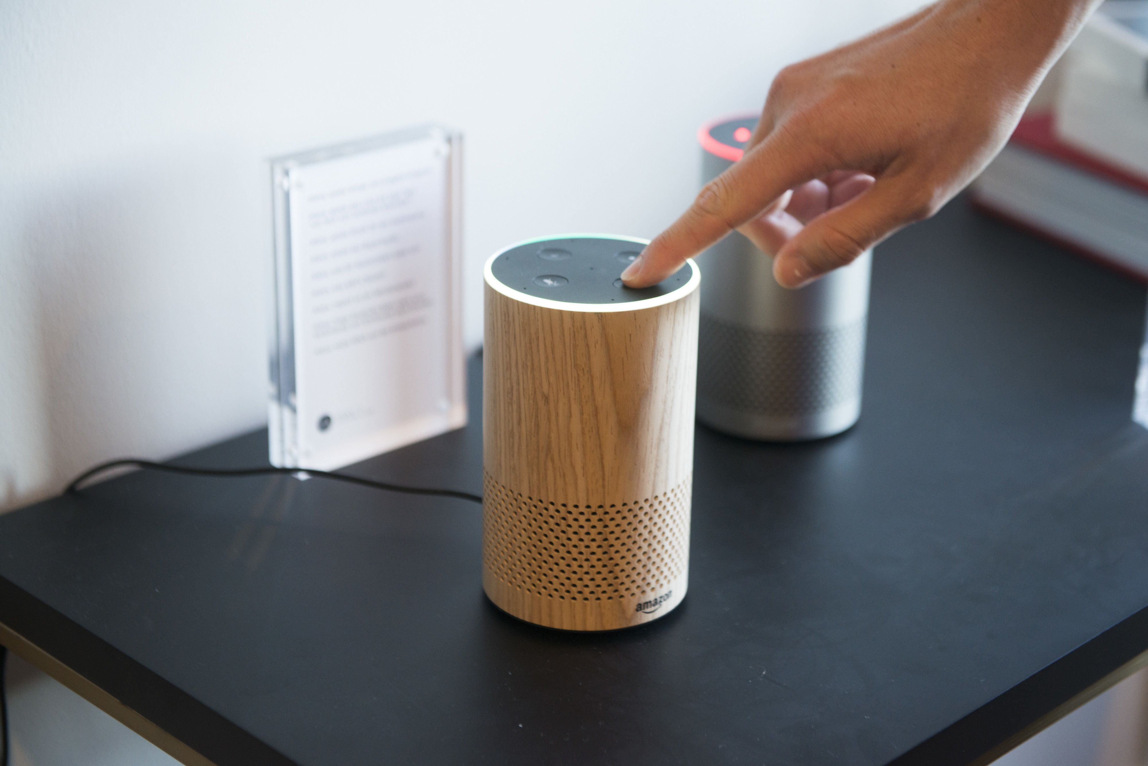 An attendee operates the new Amazon.com Inc. Echo device on display during the company's product reveal launch event in downtown Seattle, Washington, U.S., on Wednesday, Sept. 27, 2017. Amazon unveiled a smaller, cheaper version of its popular Alexa-powered Echo speaker that the e-commerce giant said has better sound. Photographer: Daniel Berman/Bloomberg via Getty Images