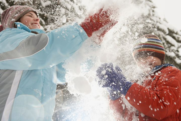 Children playing in the snow FangXiaNuo via Getty Images