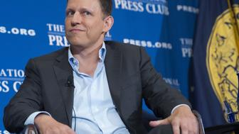 Peter Thiel, PayPal founder-turned-venture-capitalist, discusses his support for US Republican presidential nominee Donald Trump, at the National Press Club in Washington, DC, October 31, 2016. / AFP / SAUL LOEB        (Photo credit should read SAUL LOEB/AFP/Getty Images)