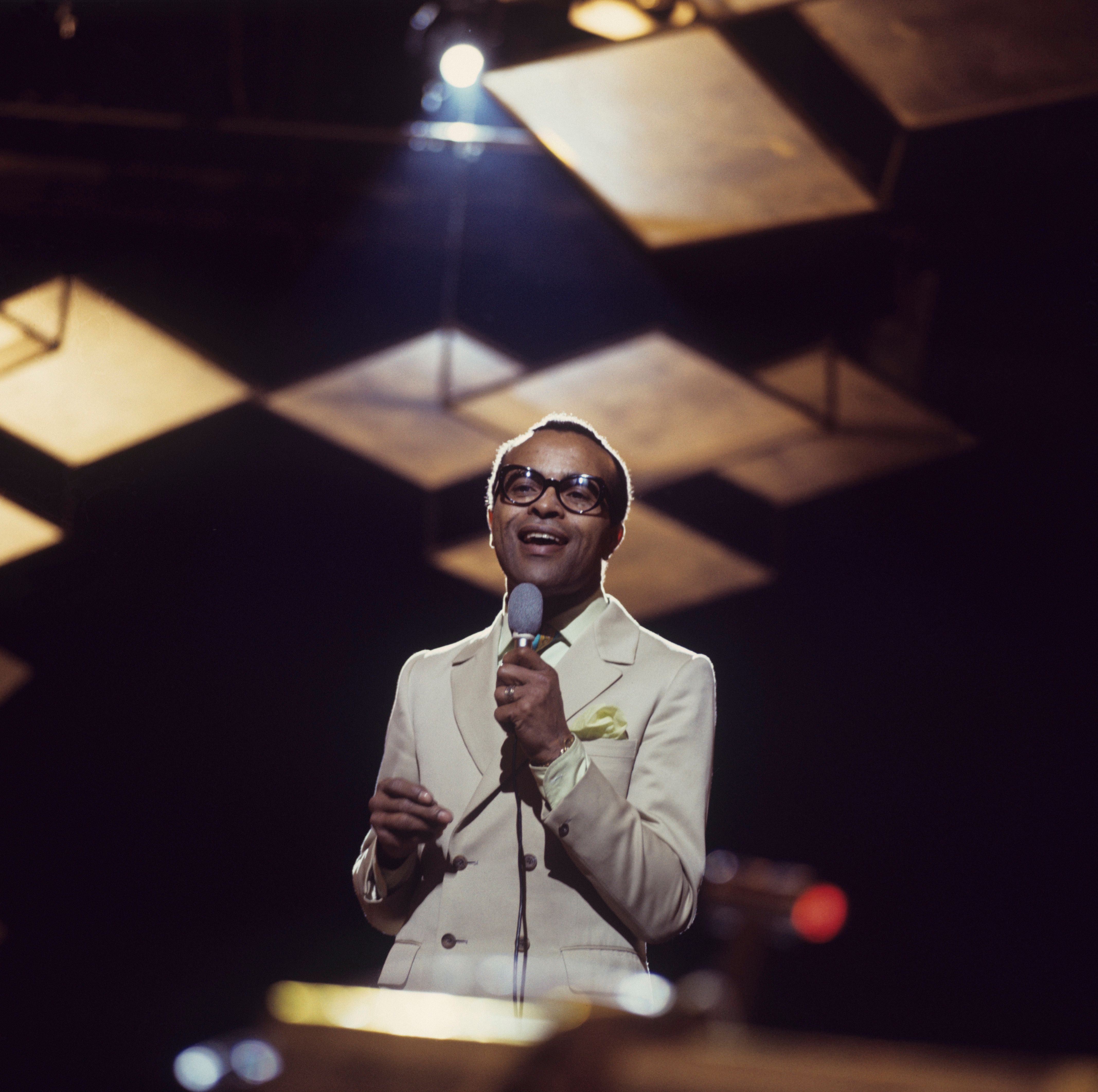 UNSPECIFIED - JANUARY 01: American jazz singer Jon Hendricks performs on stage circa 1970. (Photo by David Redfern/Redferns)