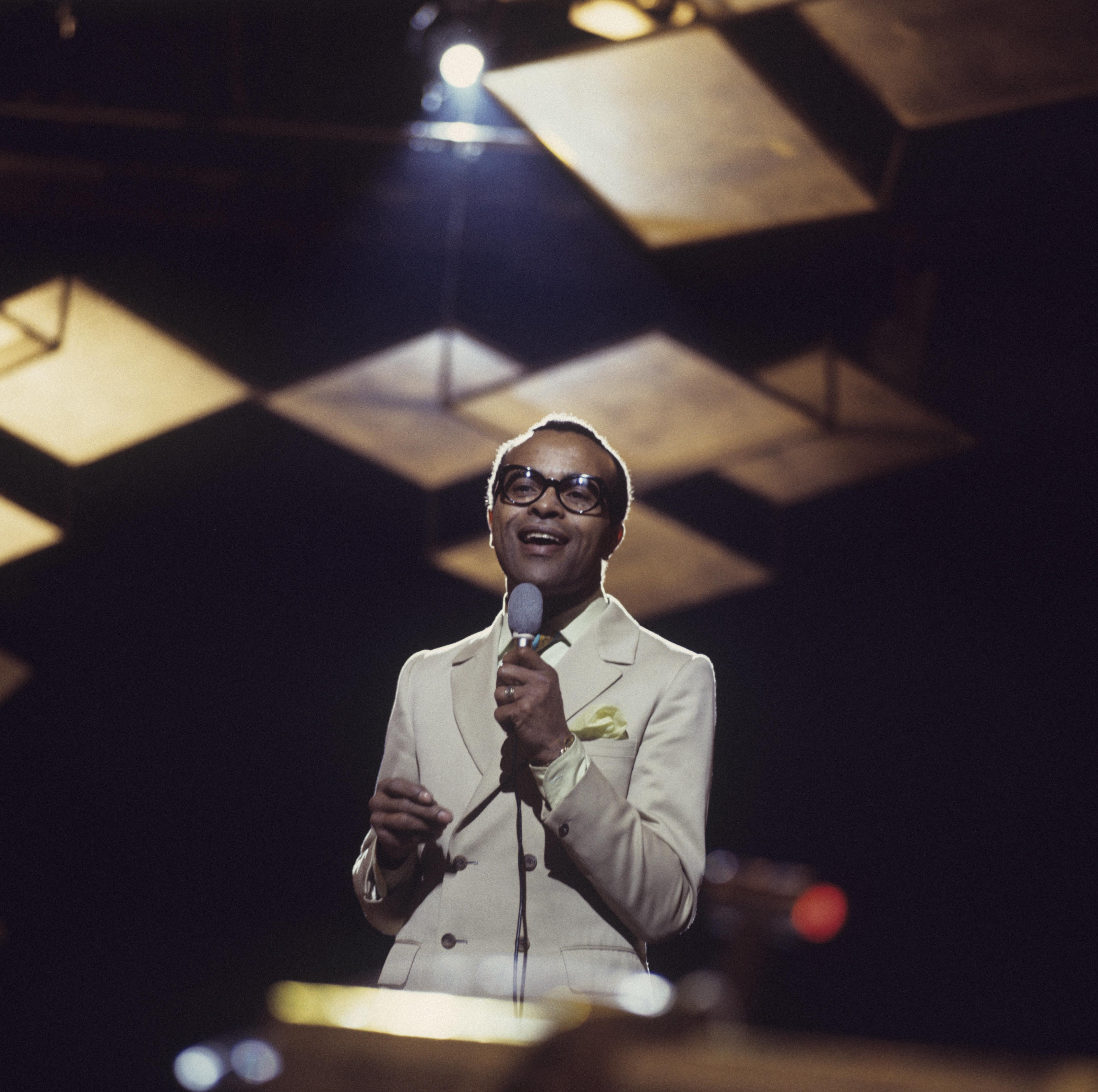Jon Hendricks performs on stage in an undated photo taken around 1970.
