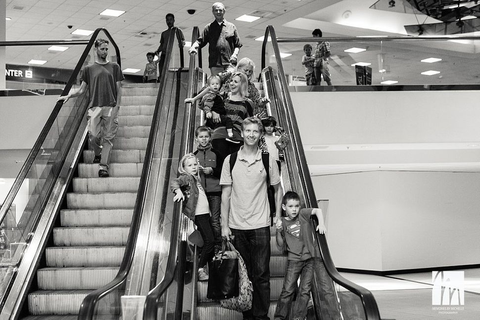 """""""I had never met this family before photographing their arrival at Sacramento airport from Ukraine, but their family had shar"""