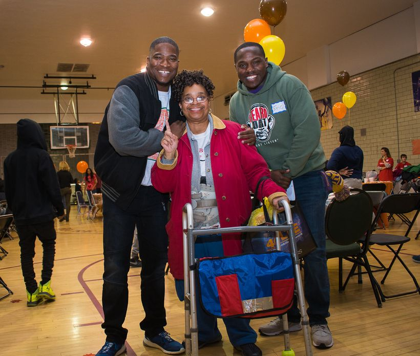 BMe Co-Founder Benjamin Evans poses with event participant and volunteer Eric Thompson at the Food From Heaven Thanksgiving e