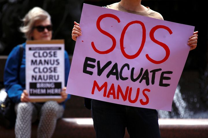 Authorities were attempting to remove hundreds of asylum seekers from a detention center in Papua New Guinea on Thursday afte
