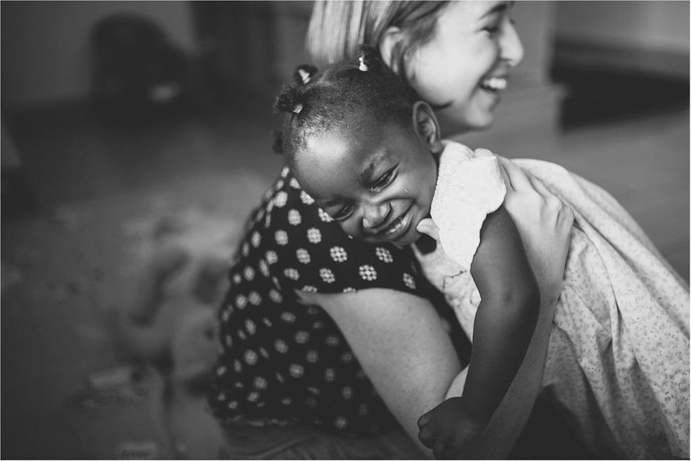 """""""After learning the corrupt side of international adoption, the Bridgers family found Mwana Villages, a holistic and ethical"""
