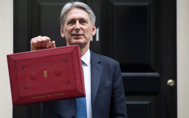 Philip Hammond poses for the cameras in Downing St ahead of the