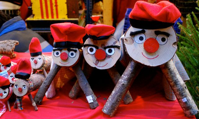 """Catalan kids beat Caga Tió with stick to receive small presents. Licensed under <a href=""""https://www.flickr.com/photos/valkyrieh116/3111553751/"""">CC BY-SA 2.0</a>."""