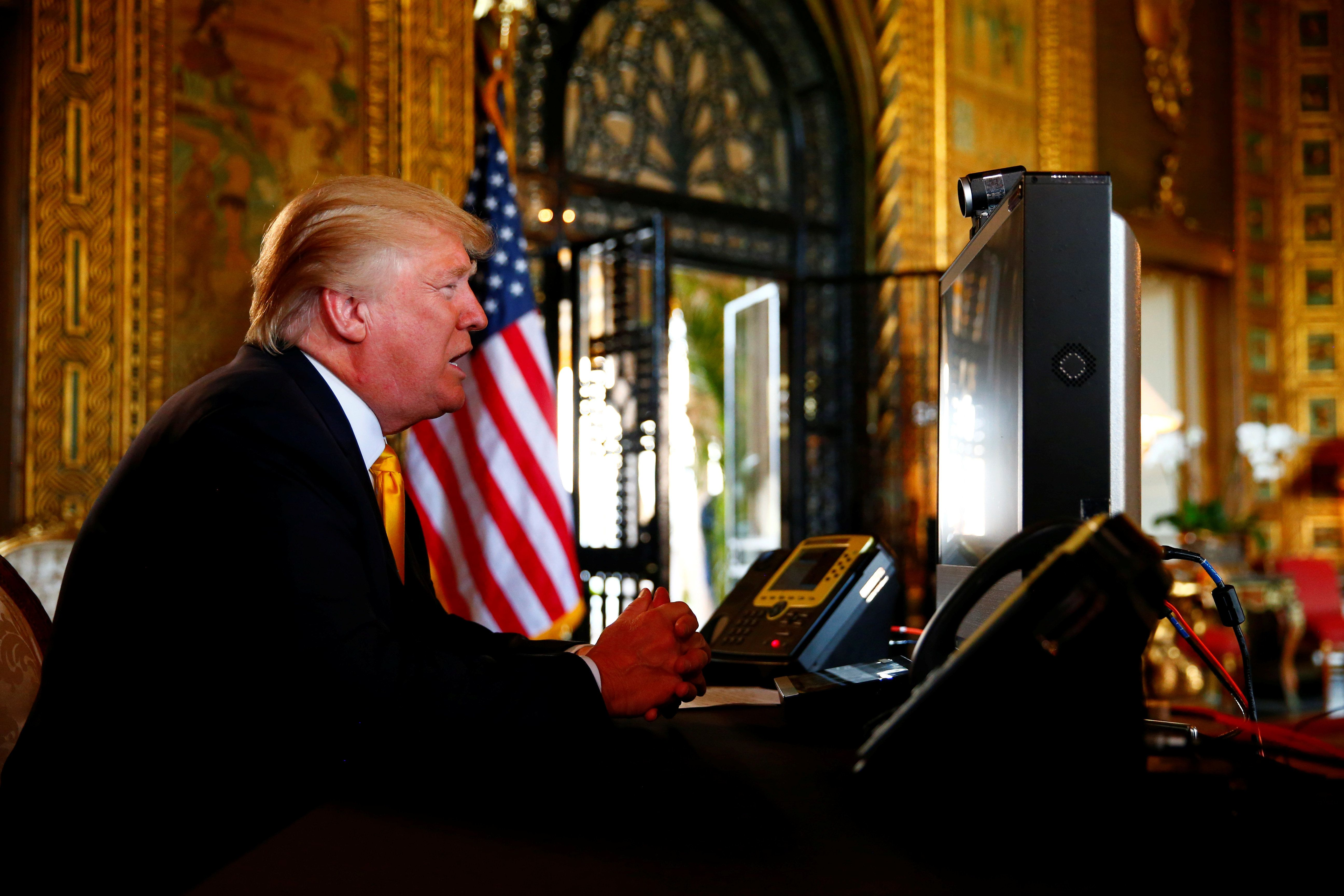 U.S. President Donald Trump speaks via video teleconference with troops from Mar-a-Lago estate in Palm Beach, Florida, U.S., November 23, 2017. REUTERS/Eric Thayer