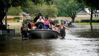 People evacuate by boat from the Hurricane Harvey floodwaters in Houston, Texas August 29, 2017. REUTERS/Rick Wilking