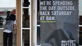 A man looks into the window of an REI store that is closed on Black Friday in Arcadia, California, November 27, 2015. Retailer Recreational Equipment Inc (REI) is keeping its stores closed on Thanksgiving and Black Friday and is encouraging people to spend the day outdoors.   REUTERS/David McNew