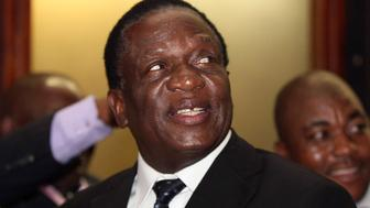 Newly appointed Zimbabwean Deputy President Emmerson Mnangagwa smiles at the headquarters of President Robert Mugabe's ZANU (PF) in Harare, December 10, 2014.   With his appointment as official deputy to 90-year-old Mugabe, justice minister Mnangagwa, a secretive hardliner known as 'The Crocodile', is well set as the eventual successor to Africa's oldest head of state.   REUTERS/Philimon Bulawayo (ZIMBABWE - Tags: POLITICS HEADSHOT)