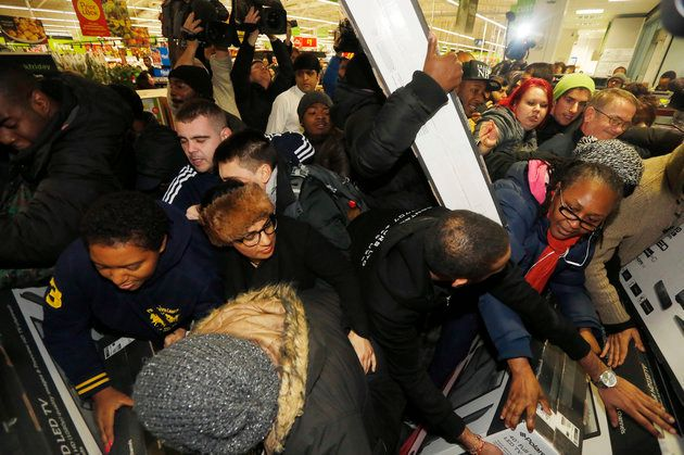 How it used to be: Shoppers fight over Black Friday deals at an Asda store in