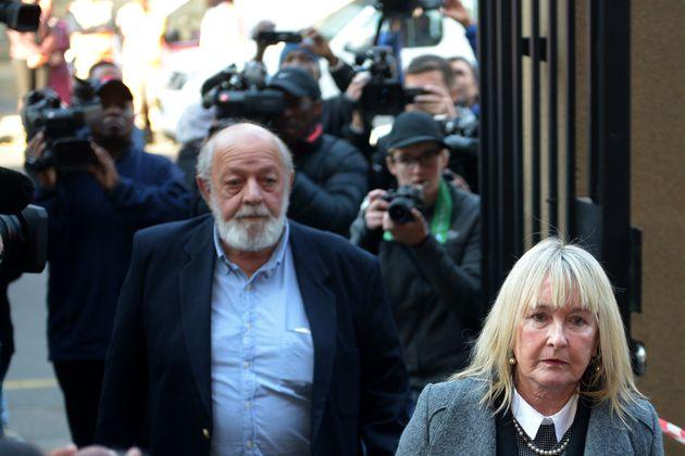 The parents of Reeva Steenkamp arrive at court for Oscar Pistorius' original sentencing for murderon...