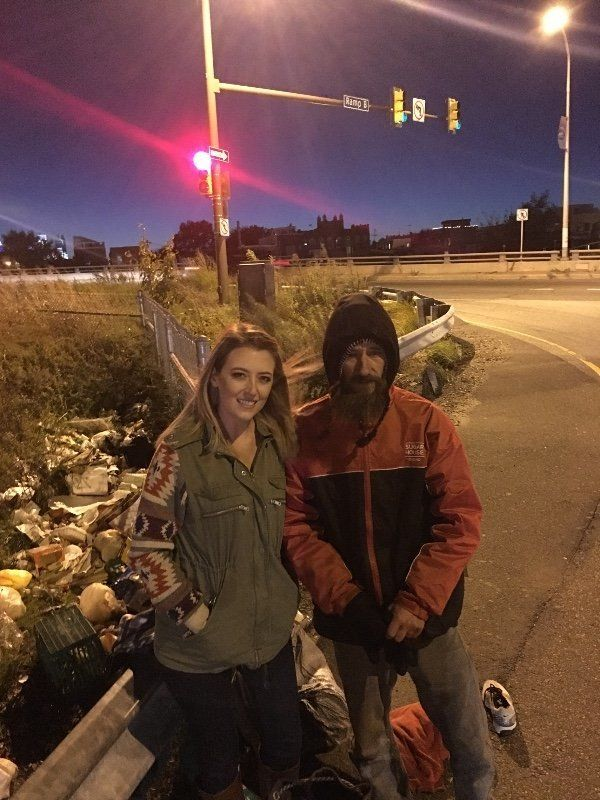 New Jersey resident Kate McClure pictured with Johnny, a homeless man who helped her when she needed it.