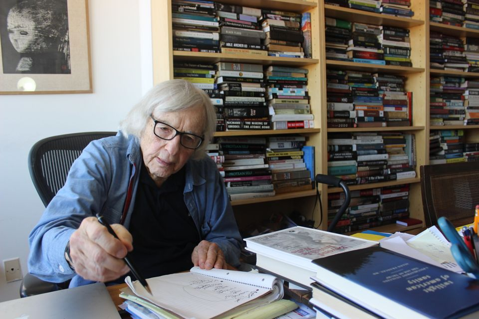 Robert Jay Lifton jots down notes in the office of his Upper West Side apartment on a sunny October