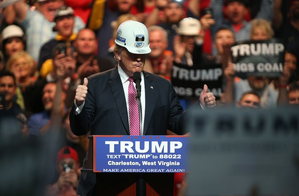 President Donald Trump posing with a hard hat in coal country during the 2016 presidential campaign.