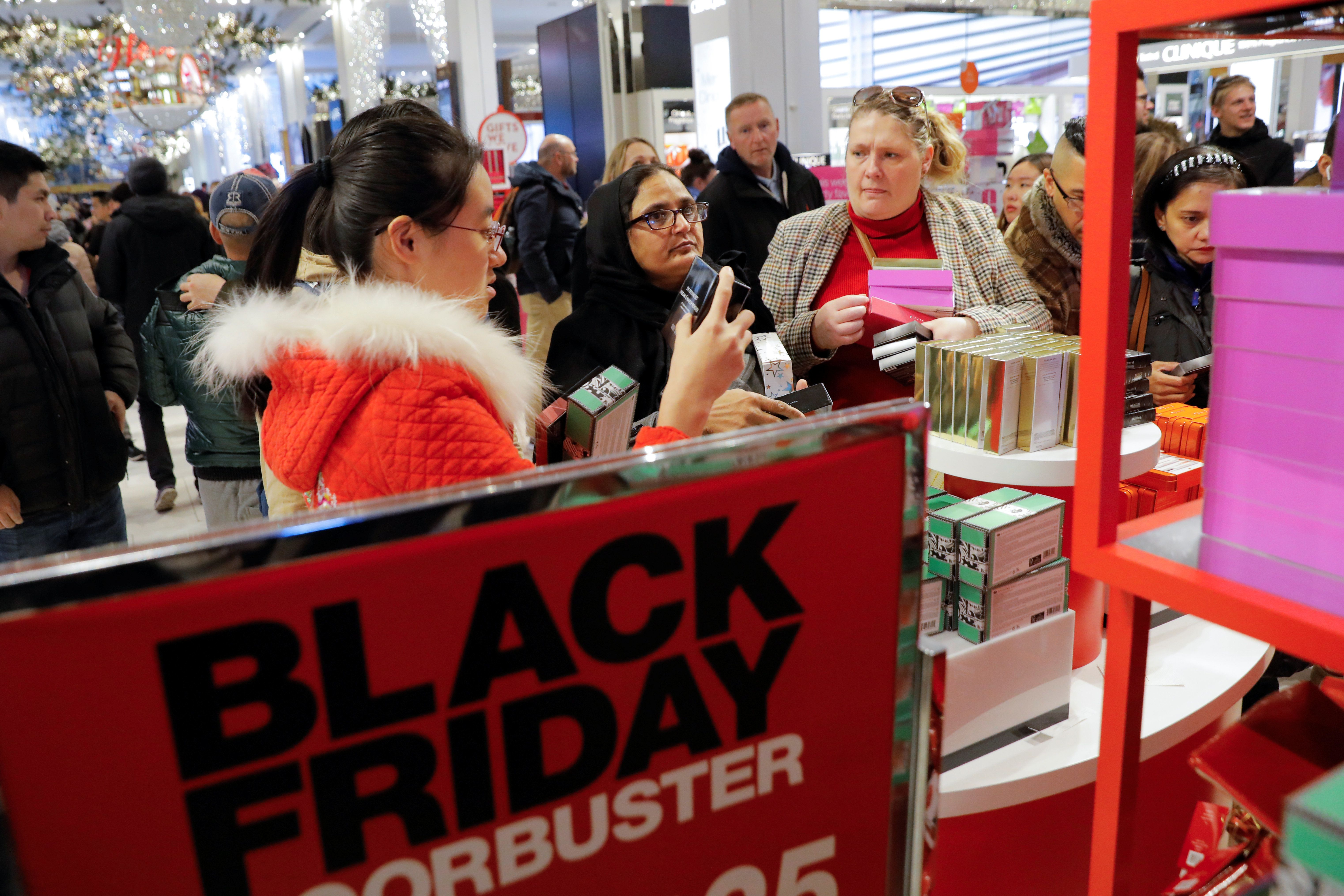 People shop for items in Macy's Herald Square during early opening for the Black Friday sales in Manhattan, New York, U.S., November 23, 2017.  REUTERS/Andrew Kelly