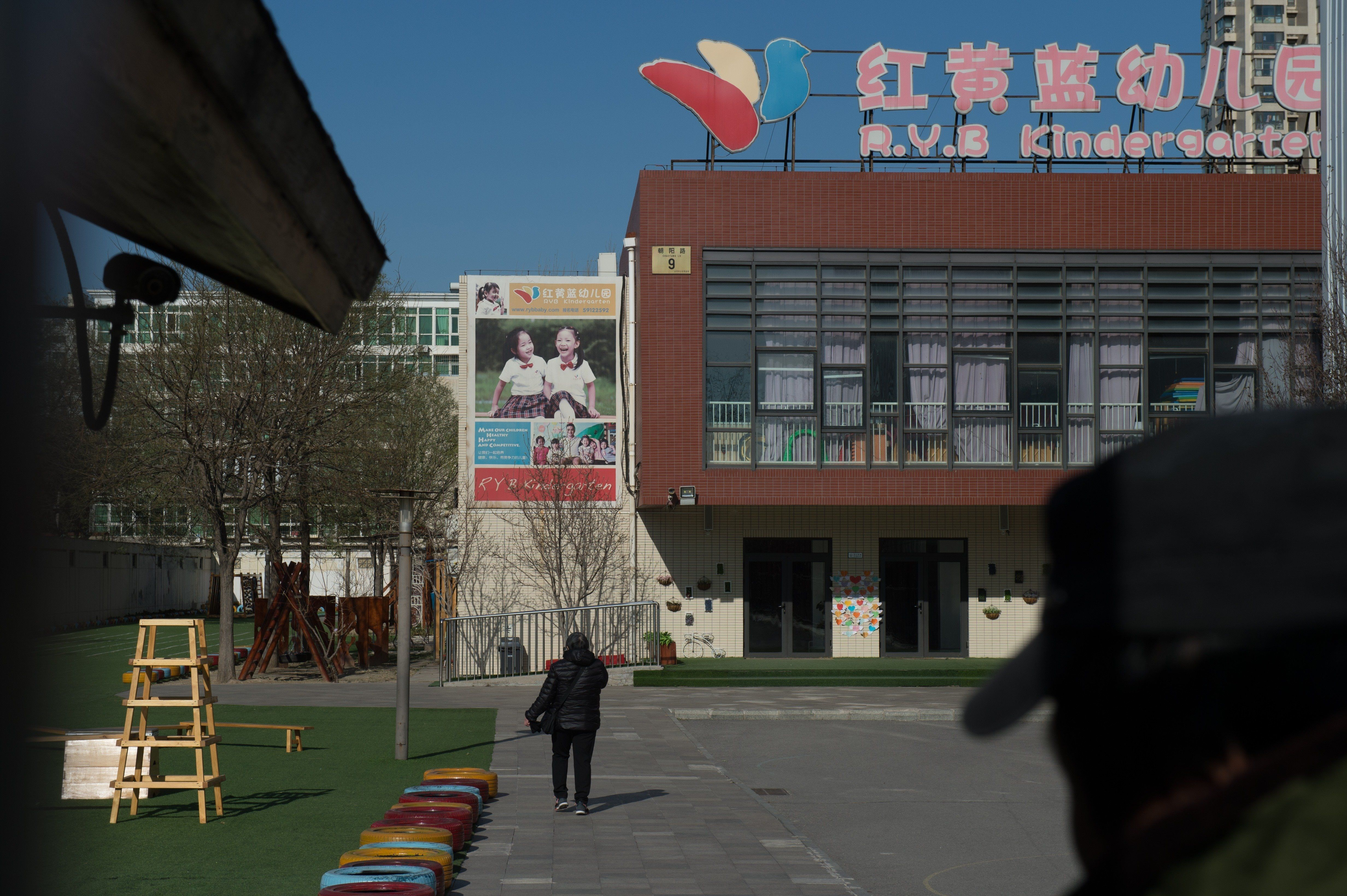 This general view shows the RYB Education New World kindergarten in Beijing on November 24, 2017. Chinese police have launched an investigation into alleged child abuse at a Beijing pre-school after parents said toddlers were apparently jabbed with needles and given mysterious pills, sparking outrage days after another daycare scandal. / AFP PHOTO / NICOLAS ASFOURI        (Photo credit should read NICOLAS ASFOURI/AFP/Getty Images)