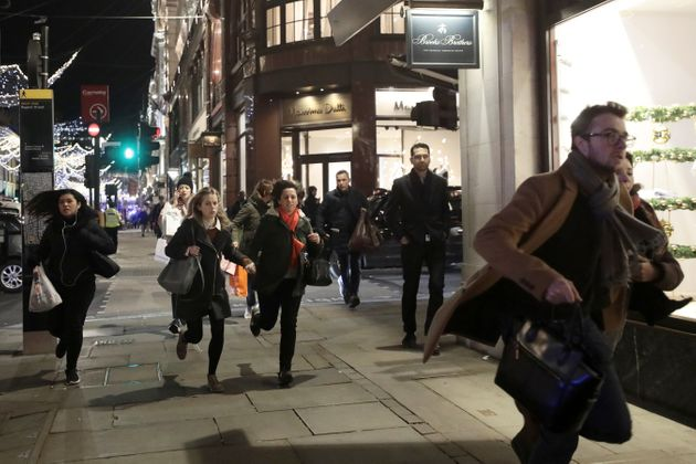 Panicked shoppers run along Oxford Street on Friday