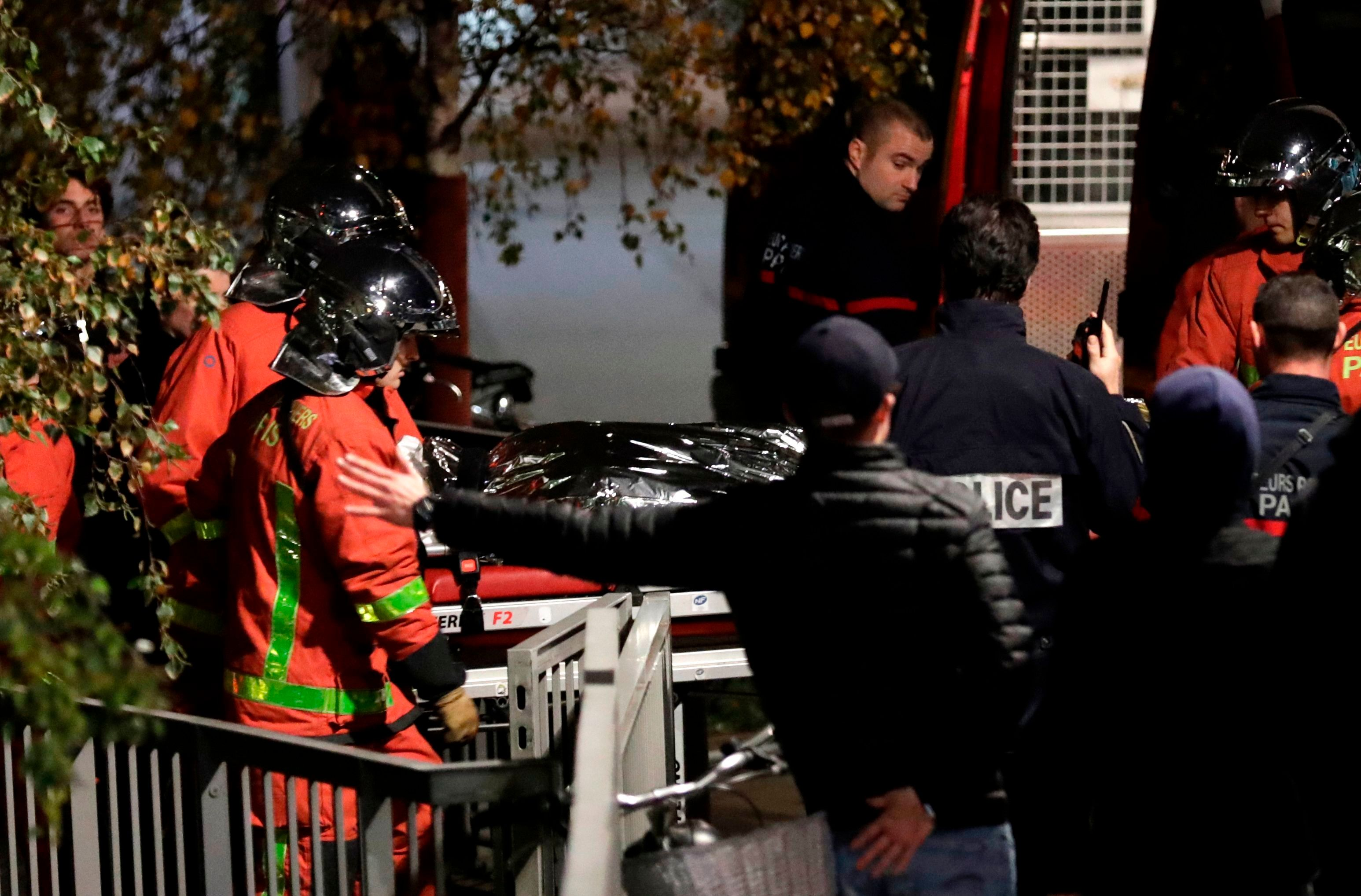 Police officials and rescue personnel transport the body of a tiger which had escaped from a circus into a vehicle in Paris on November 24, 2017, after the tiger was shot following an escape in the French capital. A tiger which escaped from a circus in Paris has been 'neutralised' by circus personnel and is now dead, police said. Firefighters had been called around 1700 GMT by people who saw the animal in the 15th Arrondissement of the French capital.  / AFP PHOTO / Thomas SAMSON        (Photo credit should read THOMAS SAMSON/AFP/Getty Images)