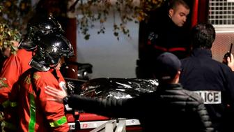 Police  transport the body of a escaped circus tiger shot dead by its owner in the middle of Paris Friday