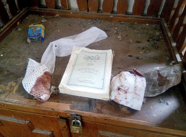 A Quran and remnants of personal belongings of victims, seen at the
