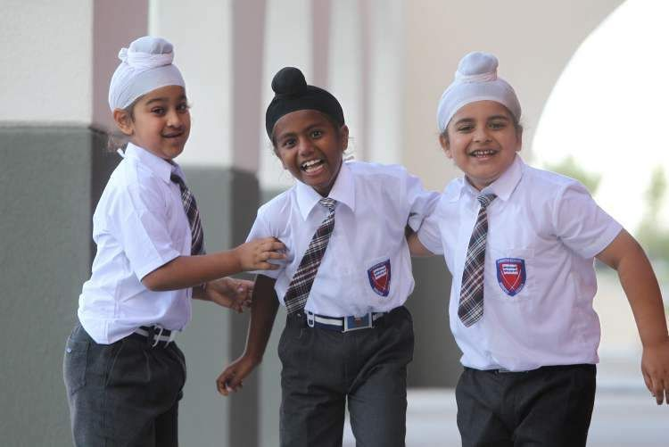 It is customary for children from Sikh communities to wear a turban to school