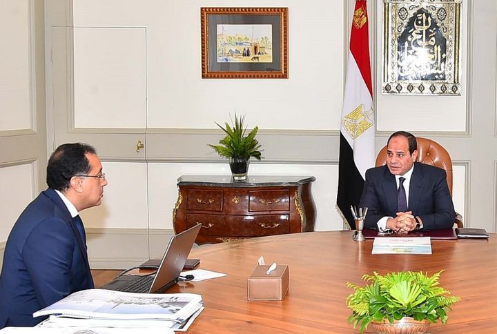 Egyptian President Abdel Fattah al-Sisi meets with Housing Minister Mustafa Madbuly, who serves as interim prime minister, to