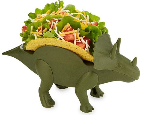 "It is a generally accepted truth that tacos taste better when <a href=""https://www.uncommongoods.com/product/tricerataco-hold"