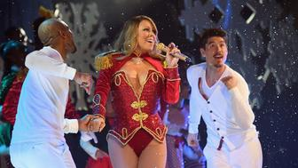 NEW YORK, NY - DECEMBER 05:  Mariah Carey (C) and dancers Anthony Burrell and Bryan Tanaka perform during the opening show of Mariah Carey: All I Want For Christmas Is You at Beacon Theatre on December 5, 2016 in New York City.  (Photo by Jeff Kravitz/FilmMagic for Mariah Carey)