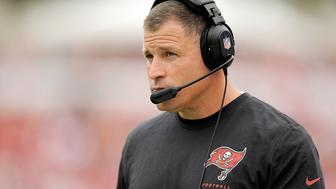 TAMPA, FL - DECEMBER 15:  Greg Schiano, head coach of the Tampa Bay Buccaneers, watches action during a game against the San Francisco 49ers at Raymond James Stadium on December 15, 2013 in Tampa, Florida.  San Francisco won the game 33-14.  (Photo by Stacy Revere/Getty Images)