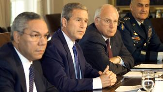 U.S. President George W. Bush holds a meeting with his national security team in the Cabinet Room of the White House, September 12, 2001. From left are Secretary of State Colin Powell, Bush, Vice President Dick Cheney and Henry Shelton, chairman of the Joint Chiefs of Staff. REUTERS/Kevin Lamarque  KL/HB