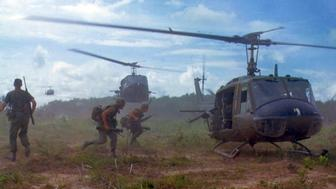 Photograph of American troops running towards a chopper during the Vietnam War. Dated 1970. (Photo by: Universal History Archive/UIG via Getty Images)