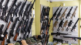 Rifle kalashnikov hangs on the wall in military store closeup