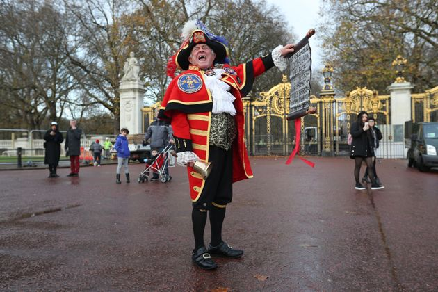 Town Crier Tony Appleton outside Green Park in central London near Buckingham Palace after it was announced...