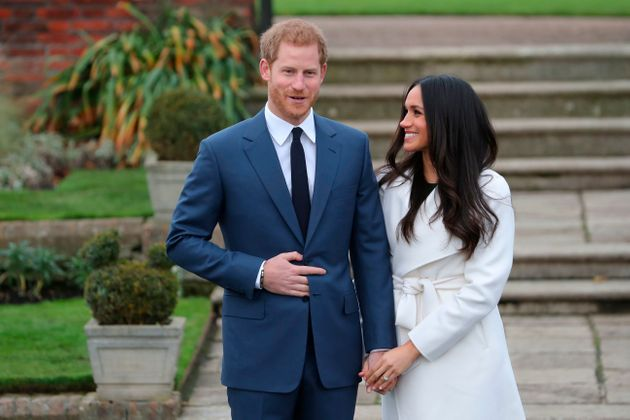 Prince Harry And Meghan Markle Pose For First Photos As Engaged