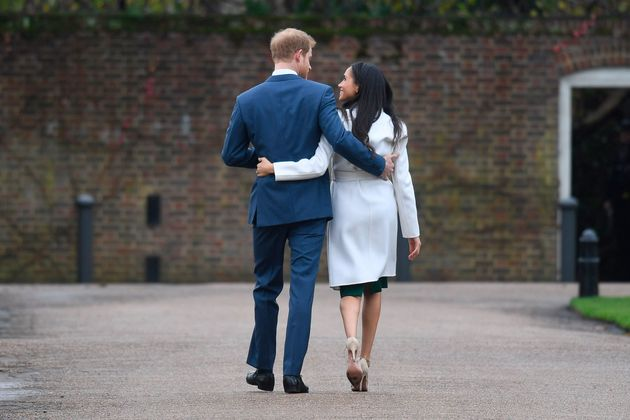 Touchy feely: The couple seemed to pay little mind to royal