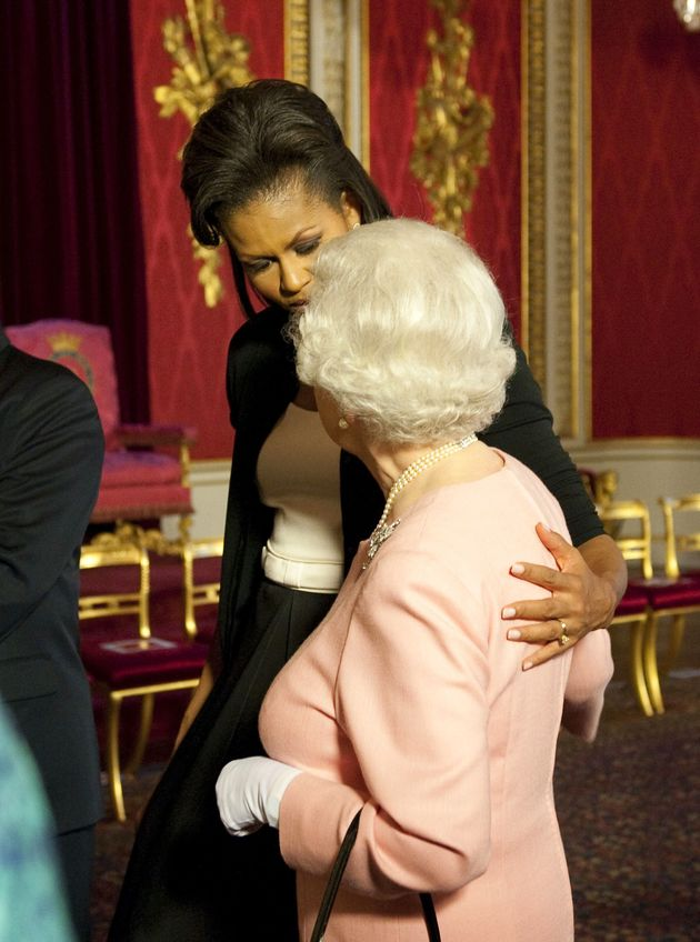 Cosy: The Queen famously embraced then First Lady Michelle