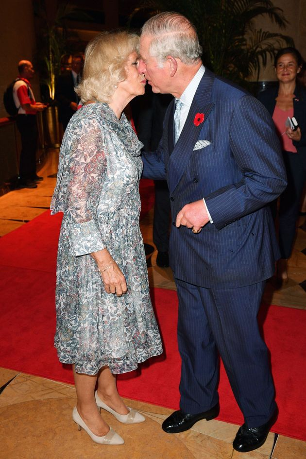 Give us a kiss: Prince Charles and Camilla pictured in Singapore in