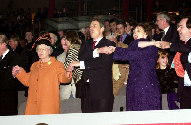 Not amused: Mirth was made when Tony Blair gripped the Queen's hand to sing Auld Lang