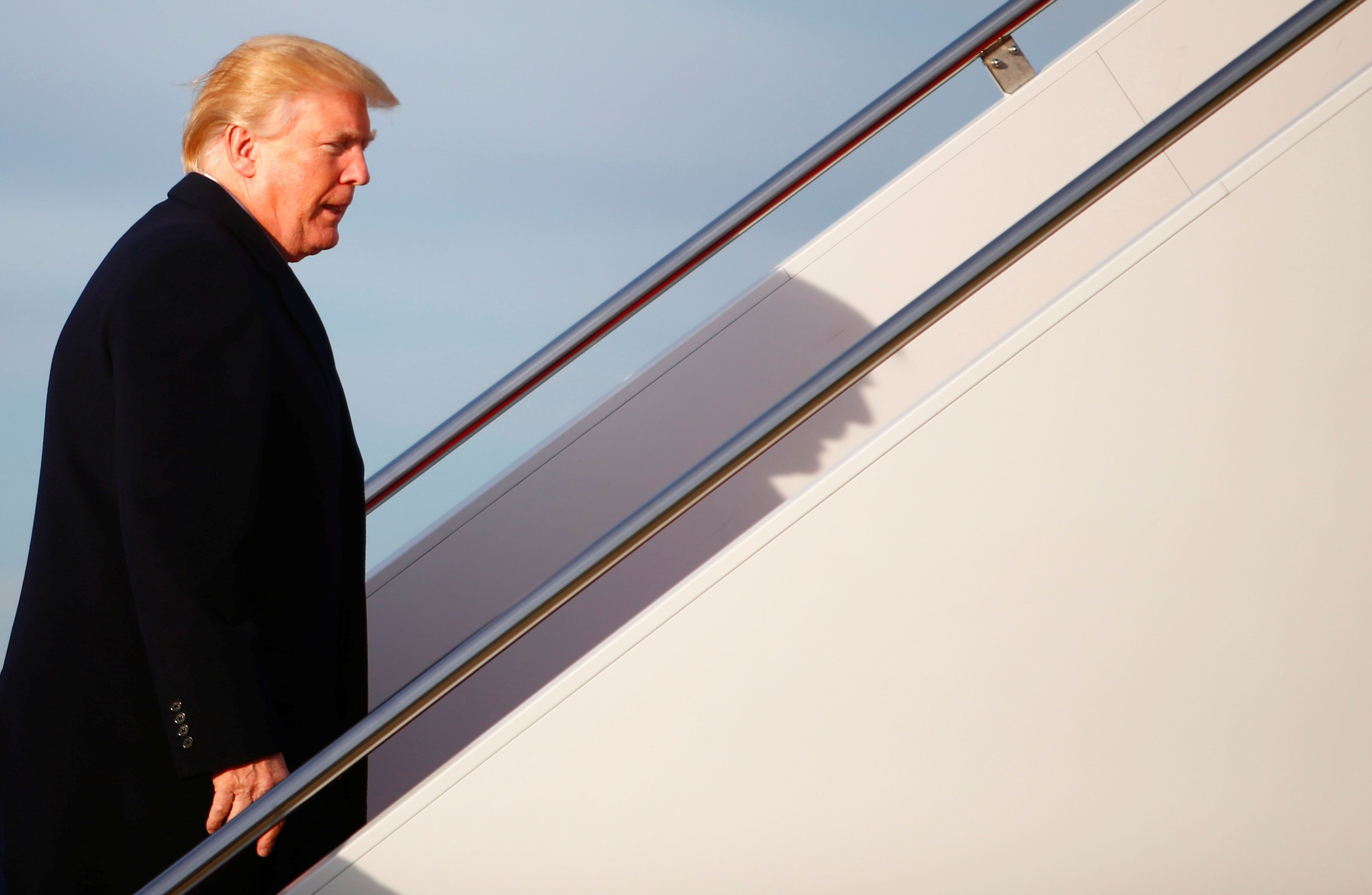 U.S. President Donald Trump boards Air Force One as he departs for West Palm Beach, Florida, from Joint Base Andrews, Maryland, U.S., November 21, 2017. REUTERS/Eric Thayer