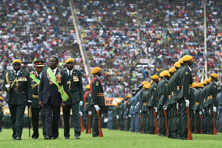 Zimbabwe's new interim president, Emmerson Mnangagwa, performs his first inspection of the Guard of Honour after he is offici