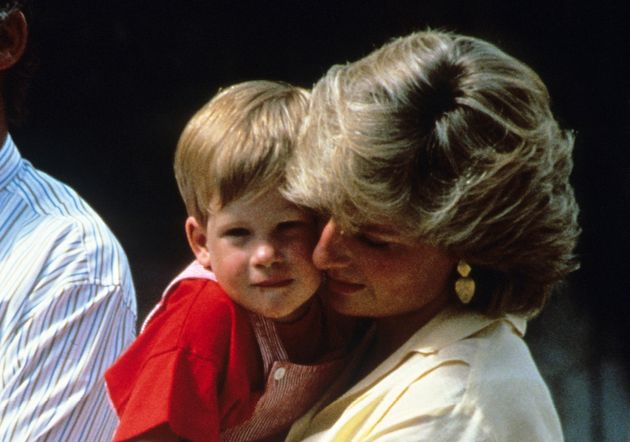 Diana, Princess of Wales, holds Prince Harry, aged 2, in