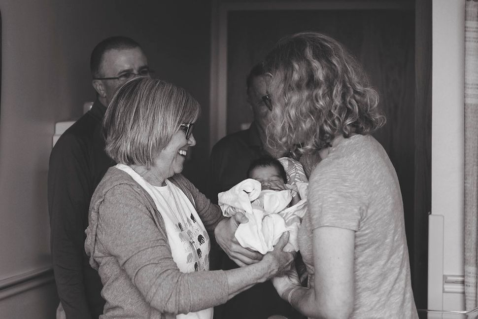 """""""Grandma meeting her adoptive granddaughter for thevery first timeand couple telling grandma that she is named af"""