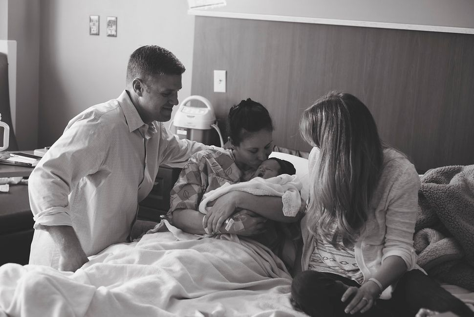 """""""Adoptive mom and dad and birth mom spending time with the baby together. Birth mom taking her in. The little girl is named J"""