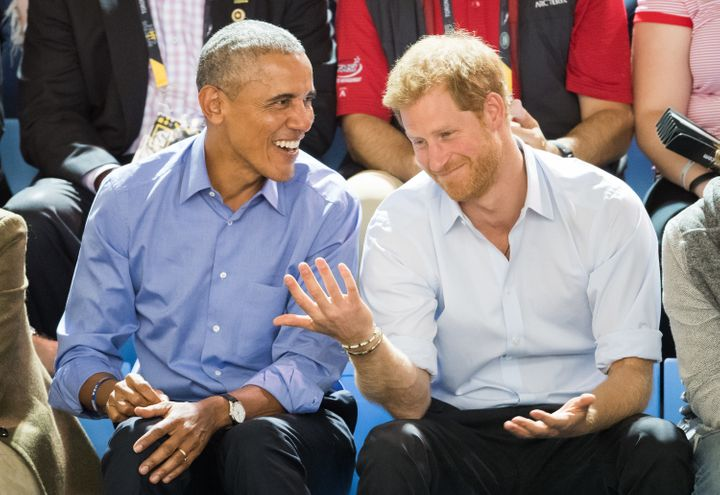 Former President Barack Obama and Prince Harry watch wheelchair basketball at the Invictus Games in Toronto on Sept. 29, 2017