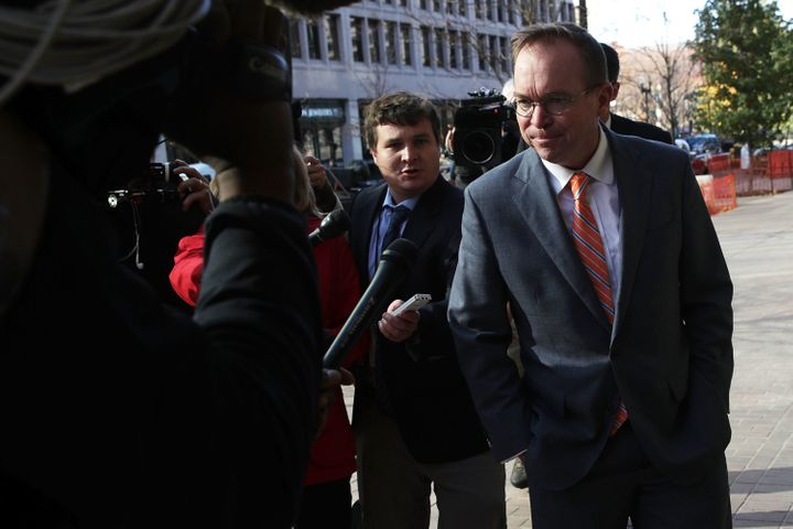 White House Budget Director Mick Mulvaney, right, is President Donald Trump's pick for acting director of the Consumer Financ