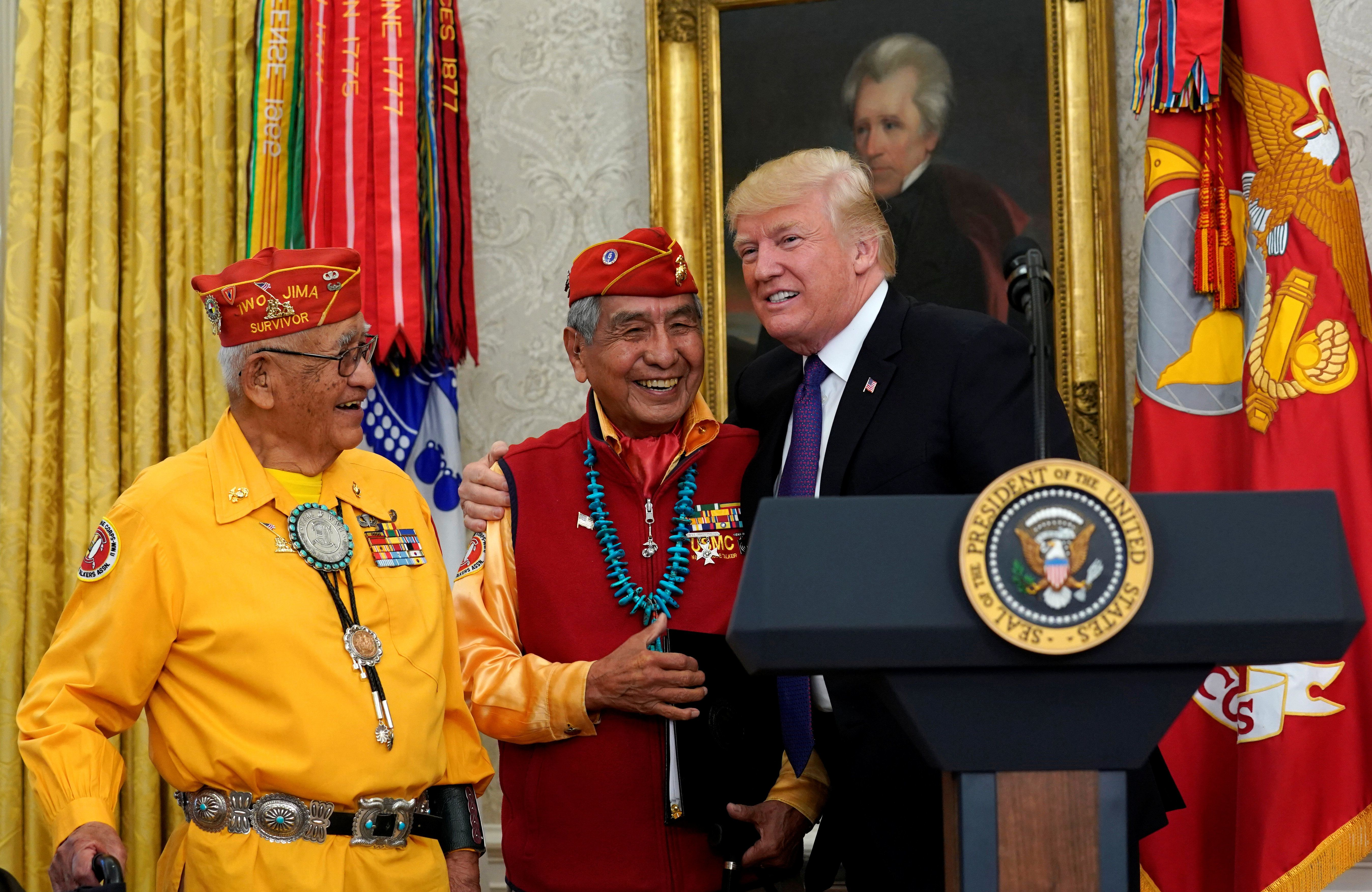 U.S. President Donald Trump hosts an event honouring the Native American code talkers, including Thomas Begay (L) and Peter McDonald, in front of a painting of President Andrew Jackson, at the White House in Washington, U.S., November 27, 2017. REUTERS/Kevin Lamarque