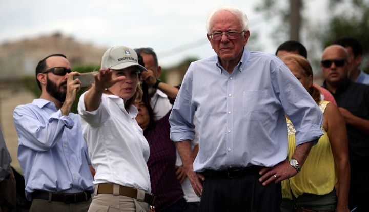 San Juan Mayor Carmen Yulín Cruz shows Sen. Bernie Sanders (I-Vt.) the  damage from Hurricane Maria during Sander
