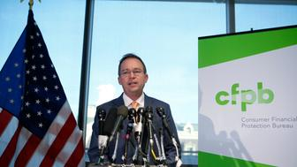Office of Management and Budget (OMB) Director Mick Mulvaney speaks to the media at the U.S. Consumer Financial Protection Bureau (CFPB),  where he began work earlier in the day after being named acting director by U.S. President Donald Trump in Washington November 27, 2017. REUTERS/Joshua Roberts